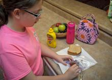 When packing lunches, children and adults need to follow good hygiene and food safety practices, such as starting with clean hands, a clean work surface and a clean lunch box. (Photo by MSU Ag Communications/Kevin Hudson)