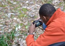 Kymari Young, a Mississippi State University Extension Service 4-H member from Simpson County, takes a close-up photo of daffodils March 8, 2015, in Natchez during a four-day photo safari. Eleven 4-H'ers from across the state visited historic sites from Leland to Natchez to improve their photography skills. (Photo by MSU Ag Communications/Susan Collins-Smith)