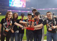 The Rankin County 4-H robotics team, Wait For It, was in the winning alliance of three teams at the FIRST Tech Challenge in Houston, Texas. Members Lilli Stewart, left, Lauren Blacksher, Noah Gregory, Maisyn Barragan, Jordan Hariel, Logan Hariel and Mathew Blacksher are on the playing field of Minute Maid Park in front of 25,000 people to receive their award on April 22, 2017. (Submitted Photo)