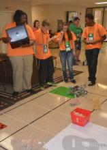 Jackson County 4-H members Ny'kqwria Crear (left), Mark Lewis, Alysia Rester and Jerrick Dubose prepare to send their robot through a challenge course during competition on June 1, 2017. More than 700 4-H members took part in contests, workshops, tours and entertainment during their annual state meeting at Mississippi State University. (Photo by MSU Extension Service/Linda Breazeale)