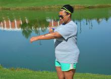 Erika Glenn of Starkville, Mississippi, does not neglect using sunscreen before exercising around Chadwick Lake on the Mississippi State University campus on June 26, 2017. (Photo by MSU Extension Service/Linda Breazeale)