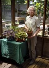 Lida McDowell holds an alternanthera plant at her home in Hattiesburg, Mississippi, on April 27, 2017. McDowell is a member of the Pine Belt Master Gardeners -- one of more than 60 such groups throughout the state that operate under the supervision of the Mississippi State University Extension Service. (Photo by MSU Extension Service/Kevin Hudson)