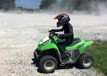 Safety gear for ATV riding includes helmets, gloves, long pants and long sleeves. Young people should ride ATVs designed for their size rather than full-size ATVs designed for adult riders. (Photo by MSU Extension Service/Bonnie Coblentz)