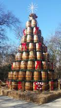 Nine layers of stacked and decorated whisky barrels make a Christmas tree shape.