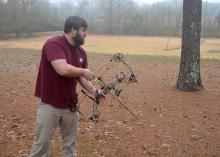 Many archers begin with a compound bow, which uses a system of pulleys and levers to bend the limbs of the bow. (Photo by MSU Extension Service/Linda Breazeale)