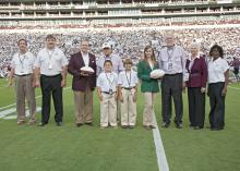 Fans celebrated a win and 4-H Youth Development Saturday, Sept. 21, 2013, at Mississippi State University's football game against Troy University. From left are Greg Bohach, vice president for the MSU Division of Agriculture, Forestry and Veterinary Medicine; Gary Jackson, director of the MSU Extension Service; MSU President Mark Keenum; Rep. Preston Sullivan with grandsons Lake and Tyler; State 4-H President Mary Kate Gaines of Coldwater; Sen. Billy Hudson and his wife, Barbara; and Paula Threadgill, Exten