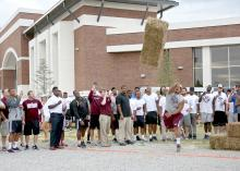 Junior Nick James of Long Beach gives his best effort during a hay bale distance-throwing contest at the fifth annual Beefing Up the Bulldogs event at Mississippi State University on Aug. 16, 2015. Event sponsors included the Mississippi Cattlemen's Association, the Mississippi Beef Council, First South Farm Credit and the MSU Department of Animal and Dairy Sciences. (Photo by MSU Ag Communications/Kat Lawrence)