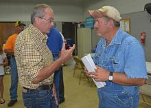 Winston County Extension agent Mike Skipper, left, discusses recovery issues from the April 2014 tornado with Rusty Suttle of Louisville at an Agricultural Disaster Resource Center set up May 15, 2014. (File photo by MSU Ag Communications/Linda Breazeale)