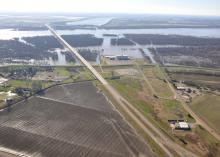 Parts of the Mississippi River have been flooding since January. The Greenville gauge reading of 56.2 feet set a record for the month. Widespread flooding can be seen looking west in this aerial photo taken Jan. 10, 2016, of the Mississippi River bridge at Greenville. (Submitted Photo by Mississippi Levee Board/Peter Nimrod)