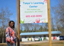 LaTonya Hill stands outside Tonya's Learning Center, her new licensed child care center in Waynesboro, Mississippi on Feb. 18, 2016.
