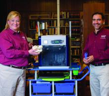 Christy King, Clarke County Extension agent, and Roberto Gallardo, an associate Extension professor in the Center for Technology Outreach, display items made with a new 3-D printer at the Quitman Public Library. (Photo by MSU Extension Service/Kevin Hudson)
