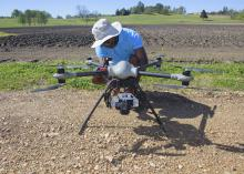 David Young, a flight coordinator with the Geosystems Research Institute at Mississippi State University, prepares an unmanned aircraft to fly over test plots at the H. H. Leveck Animal Research Center April 7, 2016. (Photo by MSU Extension/Kevin Hudson)