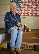 Dawn Morgan manages more than 20 hives at FloBaby Farms and sells raw honey, comb honey and beeswax from her home in Starkville, Mississippi on Nov. 22, 2016. (Photo by MSU Extension Service/Kevin Hudson)