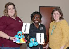 Mississippi State University Extension Service agents Jennifer Williams of Webster County, left, and Monet Kees of Pearl River County hold Dash & Dot interactive robots used by young 4-H'ers to learn STEM concepts. At right is Mariah Smith, an assistant Extension professor with the Center for Technology Outreach. Smith developed a curriculum last year that uses the robots along with mini iPads, all of which were funded through a $14,000 grant from the Verizon Foundation. (Photo by MSU Extension Service/Kat