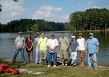 Mississippi State University students Thad Moody, Caroline Andrews, Trae Foster, Edward Entsminger, Dan Goetz, Bryant Haley and Alex Elkins prepare to sample the fish population in Larry Coleman and George Abrams' fishing pond. The students are members of MSU's chapter of the American Fisheries Society, which received the 2012 Outstanding Subunit Award during the AFS's regional meeting. (Photo courtesy of Caroline Andrews)