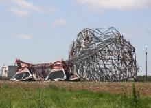 This 300-foot microwave communications tower in Noxubee County lies on the ground the day after it took a direct hit by an April 11, 2013, tornado. (Photo by MSU Extension Service/Dennis Reginelli)