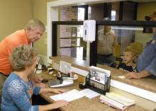 Pontotoc city clerk Dexter Warren and deputy clerk Jamie Sappington assist city residents with utility payments and other city business. The week of May 5 - 11 has been designated Municipal Clerks Week to recognize the service of clerks and their deputies to communities. (Photo by MSU Extension Service Center for Government and Community Development/Bob Ratliff)