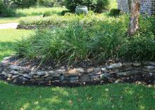 Using stone or brick to contain a raised bed makes a decorative border that keeps the landscape tidy. (Photo by MSU Ag Communications/Gary Bachman)