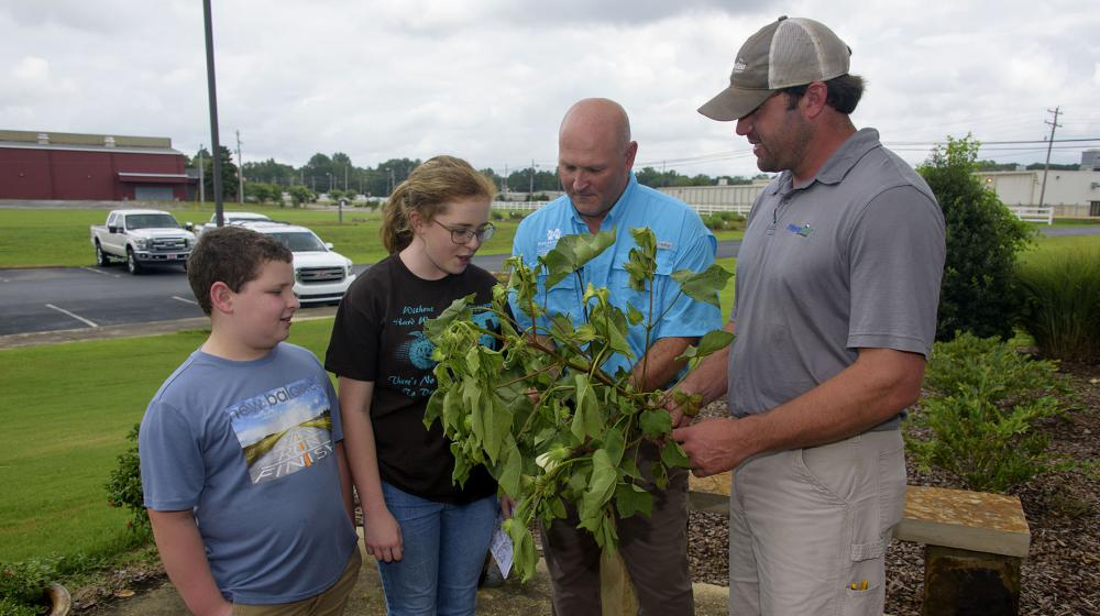 Two MSU Extension agronomy specialists instruct youth campers.