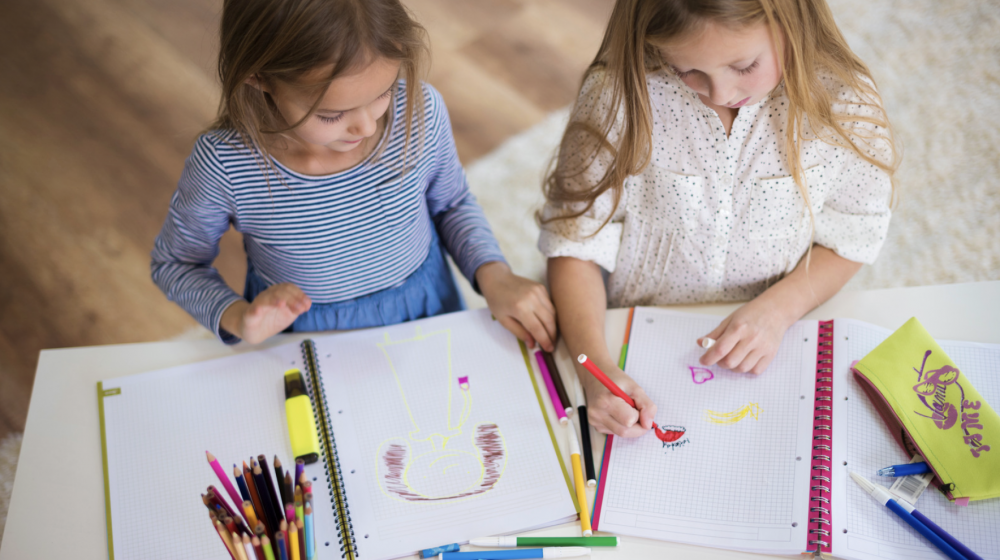 Two girls coloring.