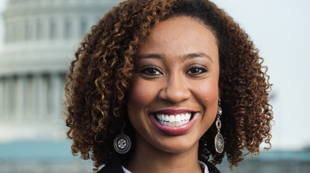 Headshot of a young black woman in business attire.
