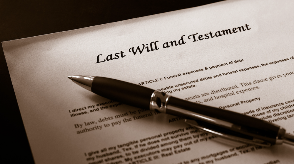 A pen lies on top of a will.