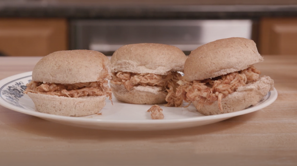 Barbecue sliders on a plate.