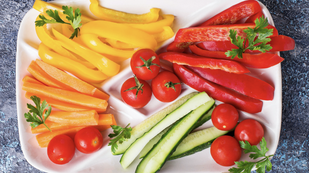 sliced bell peppers and cucumbers on a plate