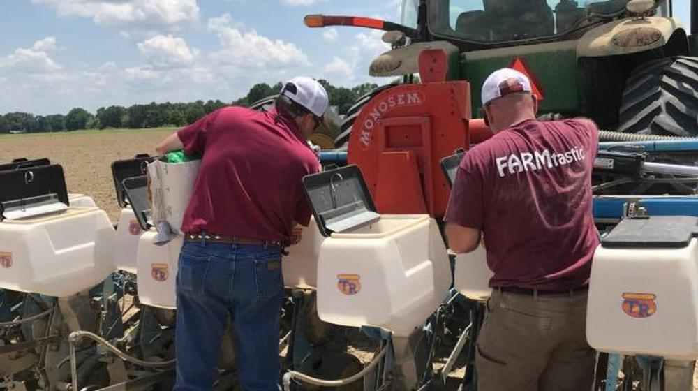 Extension Agent, Trent Barnett and Regional Agronomy Specialist , Dr. Bill Burdine working on test plots at a local farm in Calhoun County.