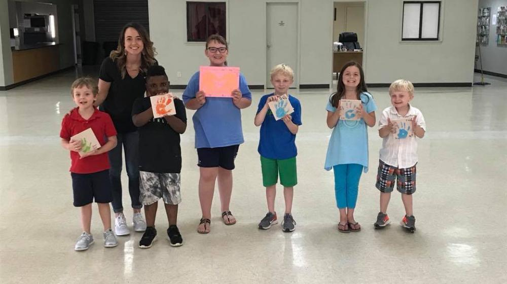 Office Associate, Katelyn Bailey with the 4-H Handy Helpers Club group.