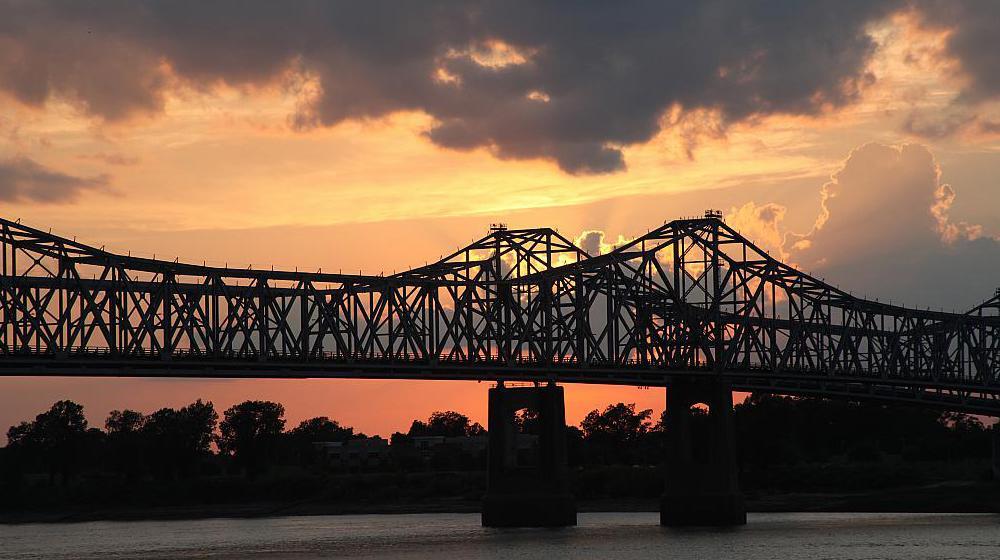 A sunset behind the Mississippi River Bridge at Natchez, Mississippi.