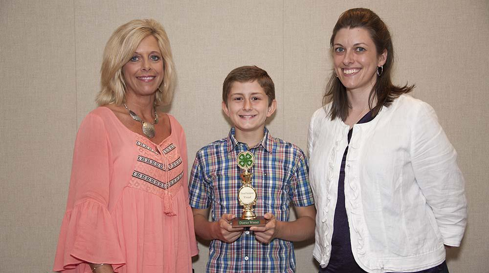 A 4-H'er receives an award.
