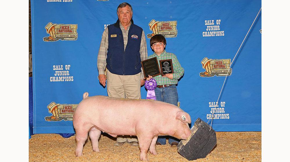A winning pig and his owner at the Sale of Junior Champions.