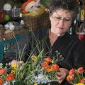 The University Florist staff stays busy preparing arrangements for weddings, parties and other special occasions. Lynette McDougald is preparing these floral arrangements for an event at the Union.