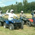 Five members of Mississippi State University's 4-H program staff raise their right hands to signal Clay County youth agent Fran Brock, who serves as the starter. From left are Betty Rawlings, Mary Riley, Landon Summers, Morris Houston and Harvey Gordon, who were test subjects for Brock's certification as a national ATV safety instructor. (Photo by Patti Drapala)