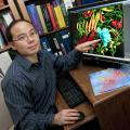 Henry Wan, assistant professor at Mississippi State University's College of Veterinary Medicine, developed a computer program that provides a better understanding of why flu viruses mutate and how they spread. (Photo by Tom Thompson)