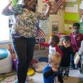 Child-care provider Dana Smith leads a dance session with Levi Mills, Carmus Batemon, Jakob Reyes, Auston Simpson and Langston Simpson at her in-home child-care program in Olive Branch. Busy Bundles of Joy Learning Center was recently recognized as a five-star center by the in-home Quality Rating and Improvement System. (Photo by MSU Extension Service/Alicia Barnes)