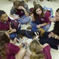 Melanie Barnett (far right), a second-year veterinary student at the Mississippi State University College of Veterinary Medicine, teaches young people enrolled in the college's Vet Camp how to perform a physical examination on a dog. (Photo by MSU College of Veterinary Medicine/Tom Thompson)