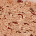 A close-up of honey-cranberry granola bars that shows in fine detail the oats and cranberries.