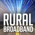 """Photo illustration with two-lane highway with computer code and the words """"Rural Broadband"""" superimposed."""