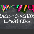Colored pencils, paper clips, tacks, markers, a ruler, scissors, and a pencil rest at the top of a chalkboard with Back-to-School Lunch Tips written on it in white chalk.