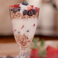 A parfait made of seasonal, locally grown blueberries, strawberries, granola, and yogurt.