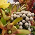 A floral arrangement with fall colors.