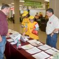 Monroe County Extension agent Randall Nevins, left, reviews horticulture career options with Karen Carothers and Elsie Buskes, both of Oxford, Mississippi. Dennis Reginelli, right, a regional specialist with the Mississippi State University Extension Service, joins the discussion at a career expo for eighth-graders in Tupelo, Mississippi, on Oct. 5, 2016. (Photo by MSU Extension Service/Linda Breazeale)