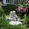 This sculpture  is surrounded by Giant Pink Supertunia and white variegated dianella behind and Big Blue Liriope.