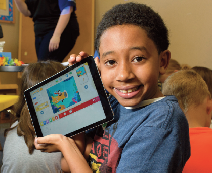 A 4-H Junior Robotics holding a tablet.