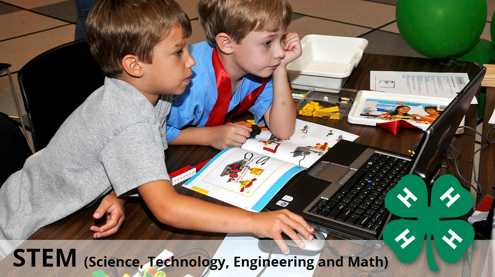 The header for the STEM section of 4-H. The image portrays youth using the LEGO software for Robotic creations.